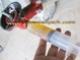การอัดจารบีหัวเกียร์เครื่องตัดหญ้าแบบสะพายหลัง