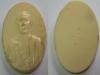 เหรียญหลวงพ่อโอภาสี (รูปไข่) เนื้อพลาสติกสีขาว รุ่นแรก