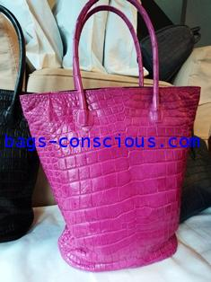 crocodile leather large bucket style bag in shocking pink