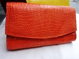 crocodile leather clutch with flap in orange