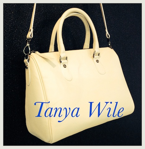 Double handle tote zip closure with leather strap in beige