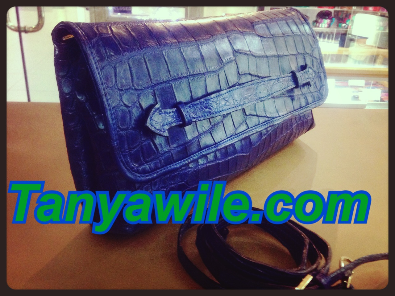 Crocodile leather clutch with strap in navy blue
