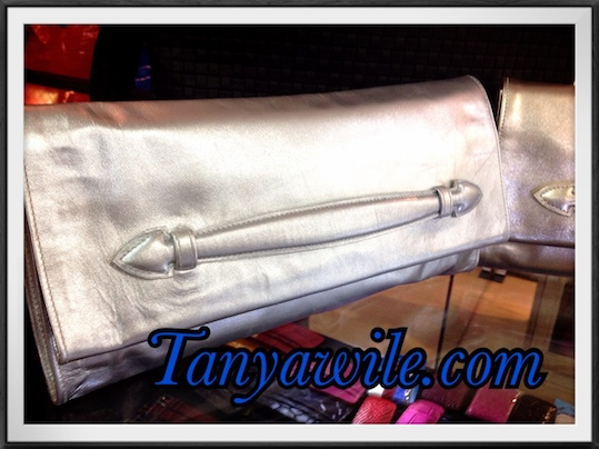 Soft leather clutch with detachable strap in metallic silver color