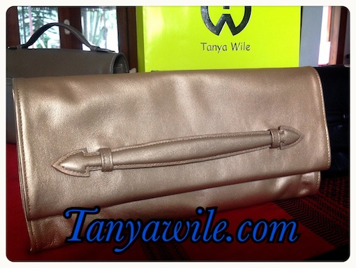 Soft leather clutch with detachable strap in metallic golden brown color lamb skin