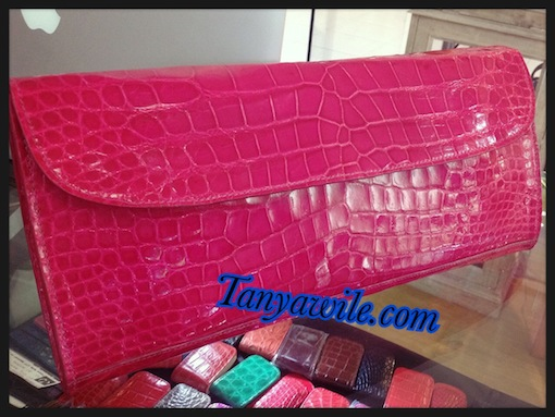crocodile leather clutch in shocking pink glazed finish